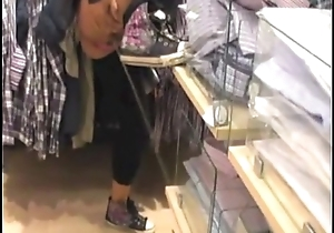 Crayz girl pissing in store - Caught on camera