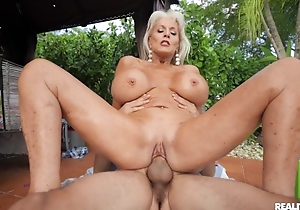Insatiable mature blonde rides young cock outdoors